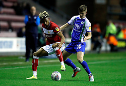 Bristol City's Lloyd Kelly (left) and Wigan Athletic's Callum Connolly (right) battle for the ball during the Sky Bet Championship match at the DW Stadium, Wigan.