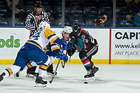 KELOWNA, CANADA - DECEMBER 1:  Nolan Foote #29 of the Kelowna Rockets is checked after the face off by Chase Wouters #44 of the Saskatoon Blades on December 1, 2018 at Prospera Place in Kelowna, British Columbia, Canada.  (Photo by Marissa Baecker/Shoot the Breeze)