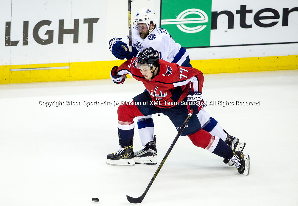 WASHINGTON, DC - MAY 21: Washington Capitals right wing T.J. Oshie (77) struggles to control the puck as Tampa Bay Lightning center Steven Stamkos (91) checks from behind during game 6 of the NHL Eastern Conference  Finals between the Washington Capitals and the Tampa Bay Lightning, on May 21, 2018, at Capital One Arena, in Washington D.C. The Caps defeated the Lightning 3-0<br /> (Photo by Tony Quinn/Icon Sportswire)