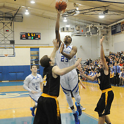 Staff photos by Tom Kelly IV<br /> Bridges goes up for a layup over two Archbishop Wood players, scoring his 1000th point.  Great Valley senior Mikal Bridges (25) scored his 1000th point Friday night December 20, 2013 in a home game against Archbishop Wood.