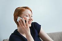 Studio shot of businessman talking on mobile phone