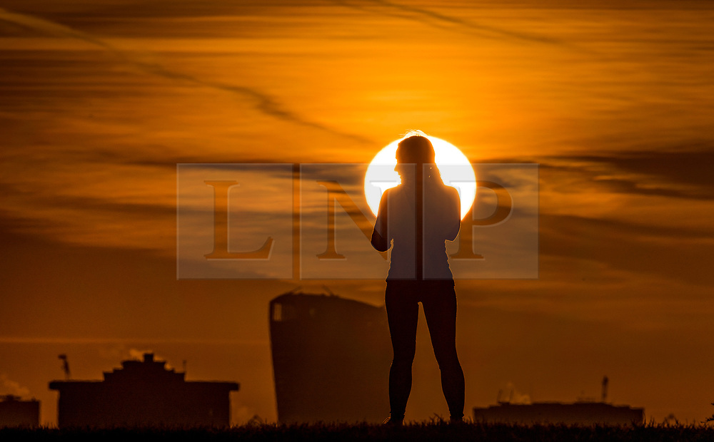© Licensed to London News Pictures. 30/01/2018. London, UK. A jogger pauses on the top of Primrose Hill as the sun rises. Photo credit: Peter Macdiarmid/LNP