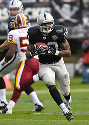 December 13, 2009; Oakland, CA, USA;  Oakland Raiders running back Darren McFadden (20) during the first quarter against the Washington Redskins at Oakland-Alameda County Coliseum.  Washington defeated Oakland 34-13.