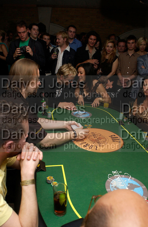 Bill Lock and Jennifer Tilley. Opening Night Party of the first  cards tournament hosted by online poker website World Poker Exchang. Old Billingsgate Market, London. 3 August 2005. ONE TIME USE ONLY - DO NOT ARCHIVE  © Copyright Photograph by Dafydd Jones 66 Stockwell Park Rd. London SW9 0DA Tel 020 7733 0108 www.dafjones.com