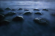 The tide moves in as a time exposure is taken at Bowling Ball Beach in Mendocino County near the town of Point Arena. The Bowling ball shaped rocks which the beach is named for vary in size from  one foot to five feet.