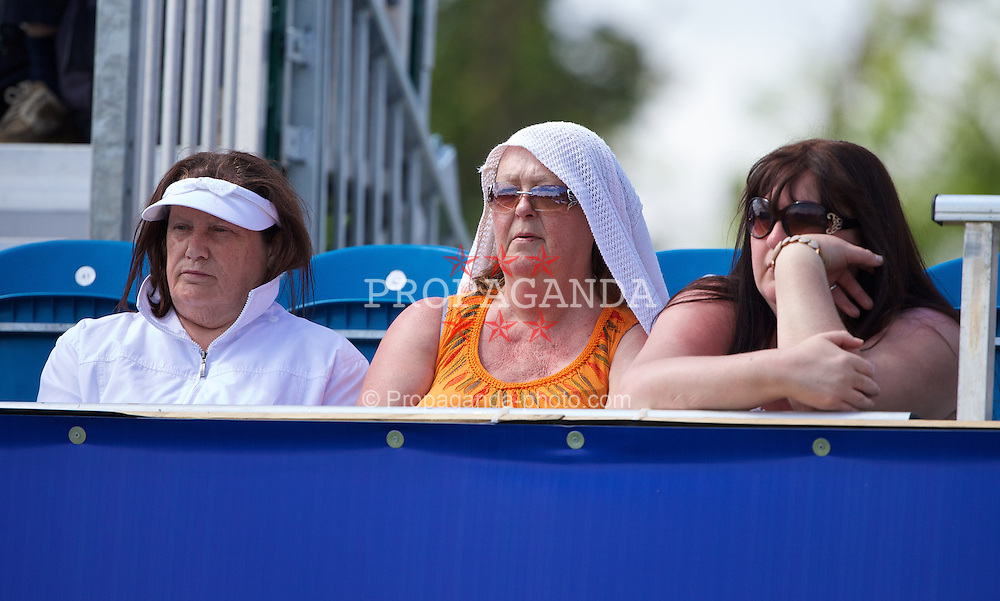 LIVERPOOL, ENGLAND - Saturday, June 21, 2014: A spectator shields herself from the sun during Men's Final during Day Three of the Liverpool Hope University International Tennis Tournament at Liverpool Cricket Club. (Pic by David Rawcliffe/Propaganda)