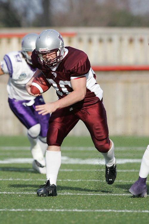 (3 November 2007 -- Ottawa) The University of Ottawa Gee Gees lost to the University of Western Ontario Mustangs 16-23 in OUA football semi-final action in Ottawa. The University of Ottawa Gee Gee player pictured in action is Justin Hammond