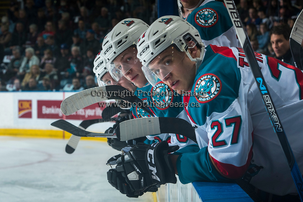 KELOWNA, CANADA - MARCH 24: Jack Cowell #8 and Calvin Thurkauf #27 of the Kelowna Rockets lean against the boards from the bench against the Kamloops Blazers on March 24, 2017 at Prospera Place in Kelowna, British Columbia, Canada.  (Photo by Marissa Baecker/Shoot the Breeze)  *** Local Caption ***