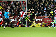 Cheltenham Town's Connor Thomas shoots at goal scores a goal 2-2  during the EFL Sky Bet League 2 match between Cheltenham Town and Forest Green Rovers at Jonny Rocks Stadium, Cheltenham, England on 29 December 2018.