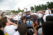 09/20/2014 - Somerville, Mass. - Tufts OL Justin Roberts, A16, celebrates on the field as fans storm the field after Tufts' 24-17 win over Hamilton at Zimman Field on Sept. 20, 2014. The win snapped a 31-game losing streak. (Kelvin Ma/Tufts University)