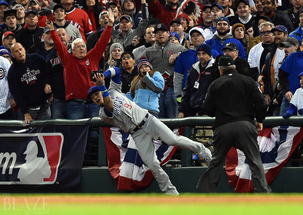 Oct 25, 2016; Cleveland, OH, USA; Chicago Cubs second baseman Javier Baez (9) catches a foul ball hit by Cleveland Indians second baseman Jason Kipnis (not pictured) in the second inning in game one of the 2016 World Series at Progressive Field. Mandatory Credit: Ken Blaze-USA TODAY Sports