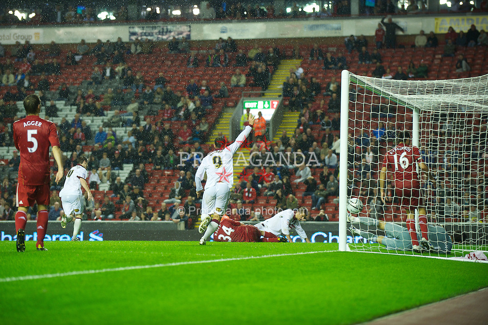 LIVERPOOL, ENGLAND - Wednesday, September 22, 2010: Northampton Town's Michael Jacobs scores his side's second goal against Liverpool during Extra Time during the Football League Cup 3rd Round match at Anfield. (Photo by David Rawcliffe/Propaganda)