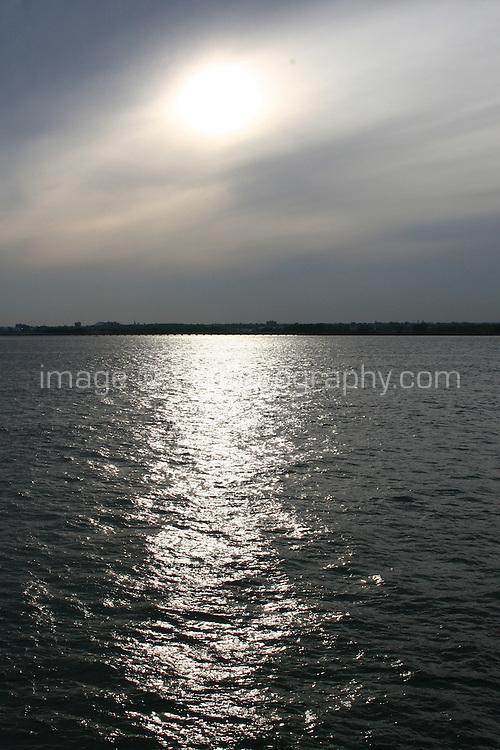Watery evening sunlight, Hudson River, New York, USA