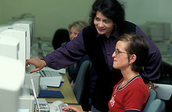 Teacher and student in computer class at FE College UK