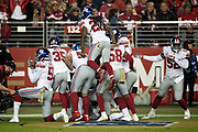 The New York Giants leap and celebrate as they pose for a group photo after a touchdown during the NFL week 10 regular season football game against the San Francisco 49ers on Monday, Nov. 12, 2018 in Santa Clara, Calif. The Giants won the game 27-23. (©Paul Anthony Spinelli)