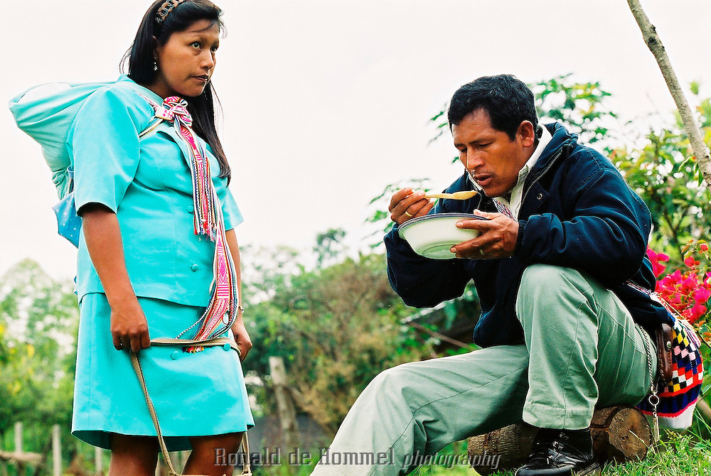 Indigenous Colombians enjoy a sancocho, a traditional Colombian soup based on meat with large pieces of plantain, potato, yuca (cassava) and vegetables. ..Toribio is a small town, capital of the mountainous region with the same name, in central Cauca Province. The area is an indigenous reserve for the Nasa indians and is governed by traditional tribal law. The indians are stuck in the middle between the permanent presence of several FARC camps and contingents of the governement army.  2003 Cauca province, southern Colombia.