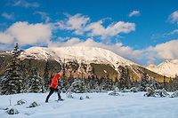 A woman snowshoes along a local trail in Girdwood, Alaska.