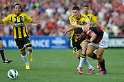 10.03.2013 Sydney, Australia. Wellingtons forward Corey Gsmeiro and Wanderers defender Adam D'Apuzzo in action during the Hyundai A League game between Western Sydney Wanderers and Wellington Phoenix FC from the Parramatta Stadium. The Wanderers won 2-1.