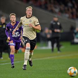 Phil Jones of Man United beats Chris HAROLD of Perth Glory for the ball