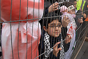Anti Israel protest, London, 17/01/09: A child watches the speeches through a fence