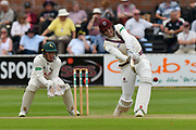Craig Overton of Somerset hits the ball over the boundary for six runs during the Specsavers County Champ Div 1 match between Somerset County Cricket Club and Nottinghamshire County Cricket Club at the Cooper Associates County Ground, Taunton, United Kingdom on 10 June 2018. Picture by Graham Hunt.