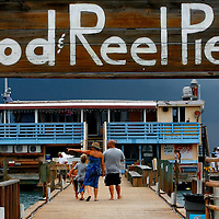 ANNA MARIA ISLAND, FL -- July 9, 2009 -- Vacationers head down the pier toward the bar and restaurant at the Rod & Reel Pier on Anna Maria Island in Manatee County, Fla., on Thursday, July 9, 2009.  (Chip Litherland for The New York Times)