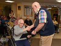Emile Ricard U.S. Army  is honored for his service during WWII with a plaque of appreciation presented by Peter Casell during the Veteran's Appreciation ceremony at the Belknap County Nursing Home on Tuesday afternoon.  (Karen Bobotas/for the Laconia Daily Sun)