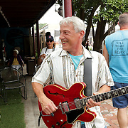 Joe Hunt, left and Jim Varno share a laugh Sunday July 27, 2014 during the All-Day Blues Jam at The Rusty Nail in Wilmington, N.C. The event was part of the 19th Annual Cape Fear Blues Festival. (Jason A. Frizzelle)
