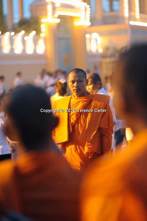Monks pose for their own photographs as they leave the Royal Palace after King Father Norodom Sihanouk's body is returned to Phnom Penh, where a week of mourning was taking place.