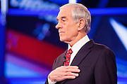 "22 FEBRUARY 2012 - MESA, AZ:      Congressman RON PAUL sings the Star Spangled Banner at the Arizona Republican Presidential Debate in the Mesa Arts Center in Mesa, AZ, Wednesday. It is the last debate before the Michigan and Arizona Republican primaries on Feb. 28 and ""Super Tuesday"" on March 6.  PHOTO BY JACK KURTZ"