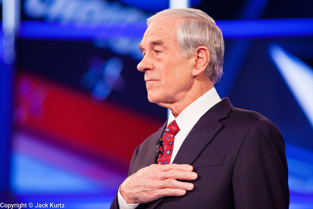 """22 FEBRUARY 2012 - MESA, AZ:      Congressman RON PAUL sings the Star Spangled Banner at the Arizona Republican Presidential Debate in the Mesa Arts Center in Mesa, AZ, Wednesday. It is the last debate before the Michigan and Arizona Republican primaries on Feb. 28 and """"Super Tuesday"""" on March 6.  PHOTO BY JACK KURTZ"""
