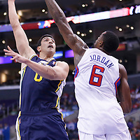 23 October 2013: Utah Jazz center Enes Kanter (0) goes for the skyhook over Los Angeles Clippers center DeAndre Jordan (6) during the Los Angeles Clippers 103-99 victory over the Utah Jazz at the Staples Center, Los Angeles, California, USA.