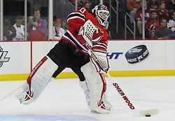 Feb 11; Newark, NJ, USA; New Jersey Devils goalie Martin Brodeur (30) plays the puck during the first period of their game against the Florida Panthersat the Prudential Center.