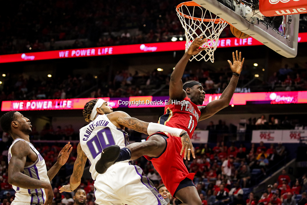 Oct 19, 2018; New Orleans, LA, USA; New Orleans Pelicans guard Jrue Holiday (11) is fouled by Sacramento Kings center Willie Cauley-Stein (00) during the second half at the Smoothie King Center. The Pelicans defeated the Kings 149-129. Mandatory Credit: Derick E. Hingle-USA TODAY Sports
