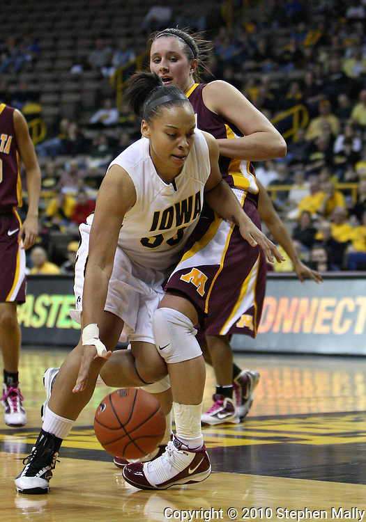 February 18, 2010: Iowa forward Gabby Machado (50) tries to drive around Minnesota forward Jackie Voigt (45) during the first half of the NCAA women's basketball game at Carver-Hawkeye Arena in Iowa City, Iowa on February 18, 2010. Iowa defeated Minnesota 75-54.