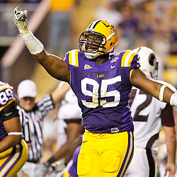 November 13, 2010; Baton Rouge, LA, USA; LSU Tigers defensive tackle Lazarius Levingston (95) celebrates after recovering a fumble against the Louisiana Monroe Warhawks during the first half at Tiger Stadium.  Mandatory Credit: Derick E. Hingle