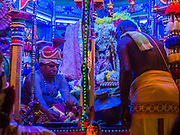 04 OCTOBER 2014 - GEORGE TOWN, PENANG, MALAYSIA: Hindu priests perform blessings during the Navratri procession. Navratri is a festival dedicated to the worship of the Hindu deity Durga, the most popular incarnation of Devi and one of the main forms of the Goddess Shakti in the Hindu pantheon. The word Navaratri means 'nine nights' in Sanskrit, nava meaning nine and ratri meaning nights. During these nine nights and ten days, nine forms of Shakti/Devi are worshiped.   PHOTO BY JACK KURTZ