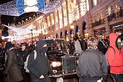 © under license to London News Pictures. 09/12/2010.  A mob, some in masks, surrounds the Royal Convoy in Regent Street after it is accidentally driven into the middle of a riot. A rioter physically attacks his wife Camilla, Duchess of Cornwall, through an open window. The Rolls Royce carrying the couple is splattered with paint and a window is smashed. Photo credit should read Cliff Hide/LNP.