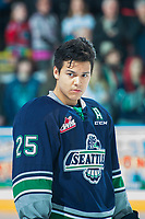 KELOWNA, CANADA - APRIL 25: Ethan Bear #25 of the Seattle Thunderbirds stands on the ice during the national anthem against the Kelowna Rockets on April 25, 2017 at Prospera Place in Kelowna, British Columbia, Canada.  (Photo by Marissa Baecker/Shoot the Breeze)  *** Local Caption ***