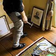 """October 13, 2015 - New York, NY : A curated reinstallation of art and antiques is currently underway in the Mayor's House, Gracie Mansion, as it is being prepped for reopening. Here, Jonathan Elliott, the consulting registrar for the Gracie Mansion Conservancy, hangs works including """"Frederick Douglass (1818 - 1895), ca. 1873,"""" a piece from the Museum of the City of New York, at right, on Tuesday. CREDIT: Karsten Moran for The New York TImes"""