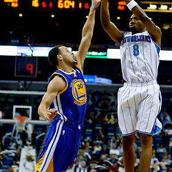 Mar 18, 2013; New Orleans, LA, USA; New Orleans Hornets shooting guard Roger Mason Jr. (8) shoots over Golden State Warriors point guard Stephen Curry (30) during the first quarter a game at the New Orleans Arena Mandatory Credit: Derick E. Hingle-USA TODAY Sports