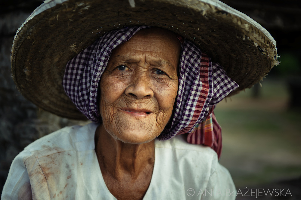 Cambodia. Angkor Wat. Elderly Khmer woman wearing a typical headdress.