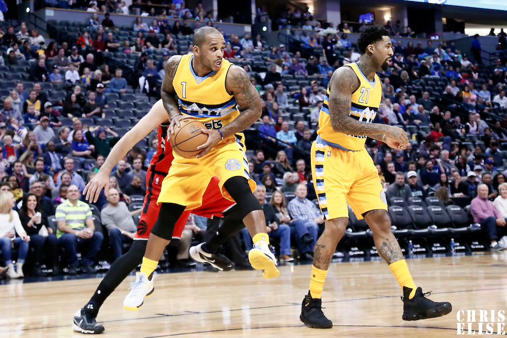 18 November 2016: Denver Nuggets guard Jameer Nelson (1) grabs a rebound next to Denver Nuggets forward Wilson Chandler (21) during the Toronto Raptors 113-111 OT victory over the Denver Nuggets, at the Pepsi Center, Denver, Colorado, USA.