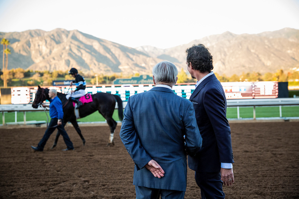 December 26 2014: Trainer, Jerry Hollendorfer and owner Jim Rome watch Shared Belief after winning the Malibu Stakes at Santa Anita Park in Arcadia CA. Alex Evers/ESW/CSM