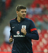 Picture by John Rainford/Focus Images Ltd +44 7506 538356<br /> 14/08/2013<br /> Steven Gerrard, captain of England warms up before the International Friendly match at Wembley Stadium, London.