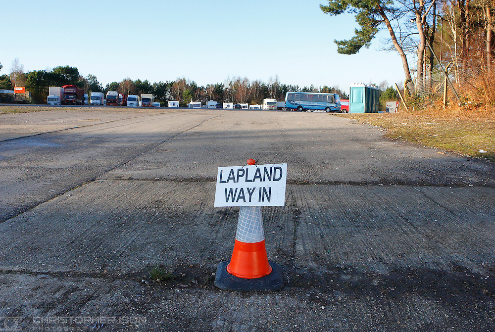 A sign attached to a traffic bollard welcomes visitors to Lapland New Forest, which opened on November 28 at Matchams Leisure Park near Ringwood. The sign stands a few yards from portable toilets and parked HGV's. Trading Standards are investigating after the Christmas attraction in Dorset was described by one disgruntled visitor as more like a car boot sale.