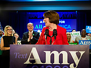03 FEBRUARY 2020 - DES MOINES, IOWA: US Senator AMY KLOBUCHAR (D-MN) looks back to her daughter, ABIGAIL BESSLER, left, and her husband, JOHN BESSLER, center, during her speech at her caucus night party at the downtown Marriott Hotel in Des Moines. The party was her last Iowa appearance of the primary season. Iowans made the first presidential selection picks of the 2020 election campaign with the Iowa caucuses Monday night.  PHOTO BY JACK KURTZ
