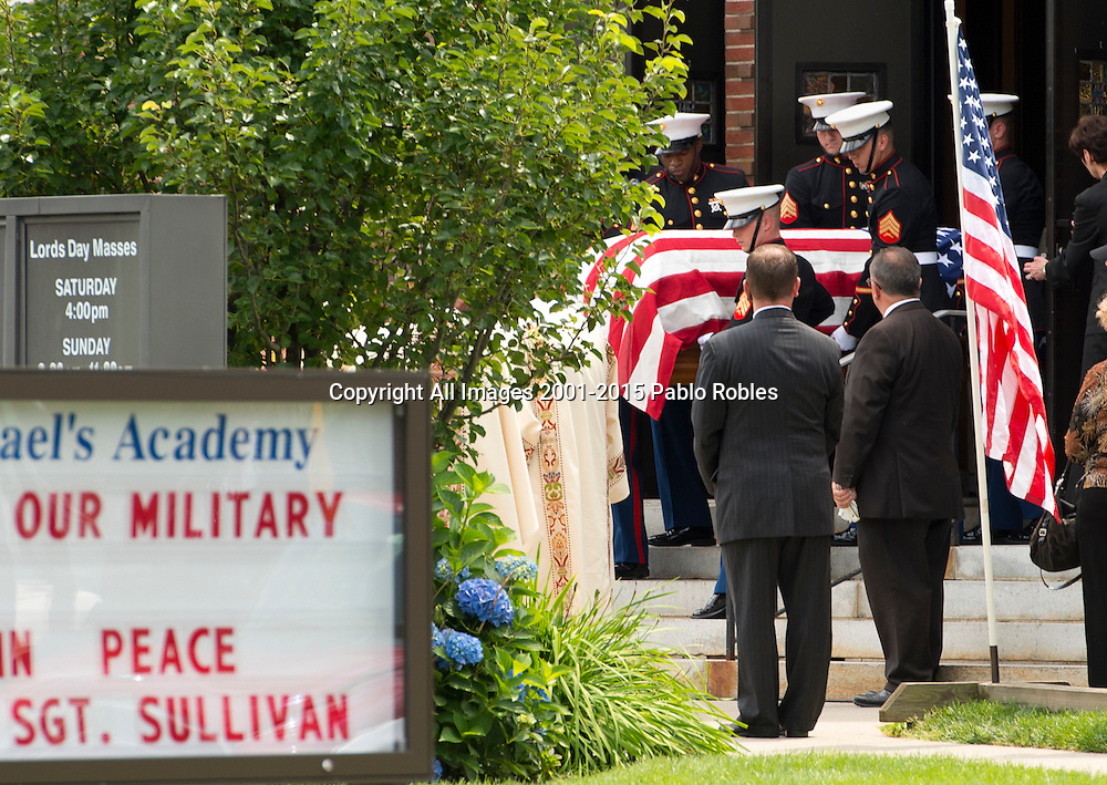 Marine Pallbearers carry the casket of Marine Gunnery Sgt. Thomas Sullivan in Springfield, Mass., Monday, July 27, 2015. Sullivan is one of the five service men killed in the July 16 shooting in Chattanooga, TN. Spot News, General News images for Newspapers by Photojournalist Pablo Robles.