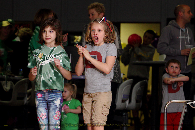 Teams participate in Bowl for Kids' Sake at Poelking Woodman Lanes in Dayton, Saturday, March 16, 2013.