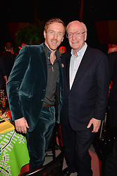 Left to right, DAMIAN LEWIS and SIR MICHAEL CAINE at A Night of Reggae in aid of Save The Children held at The Roundhouse, Chalk Farm Road, London NW1 on 12th March 2014.